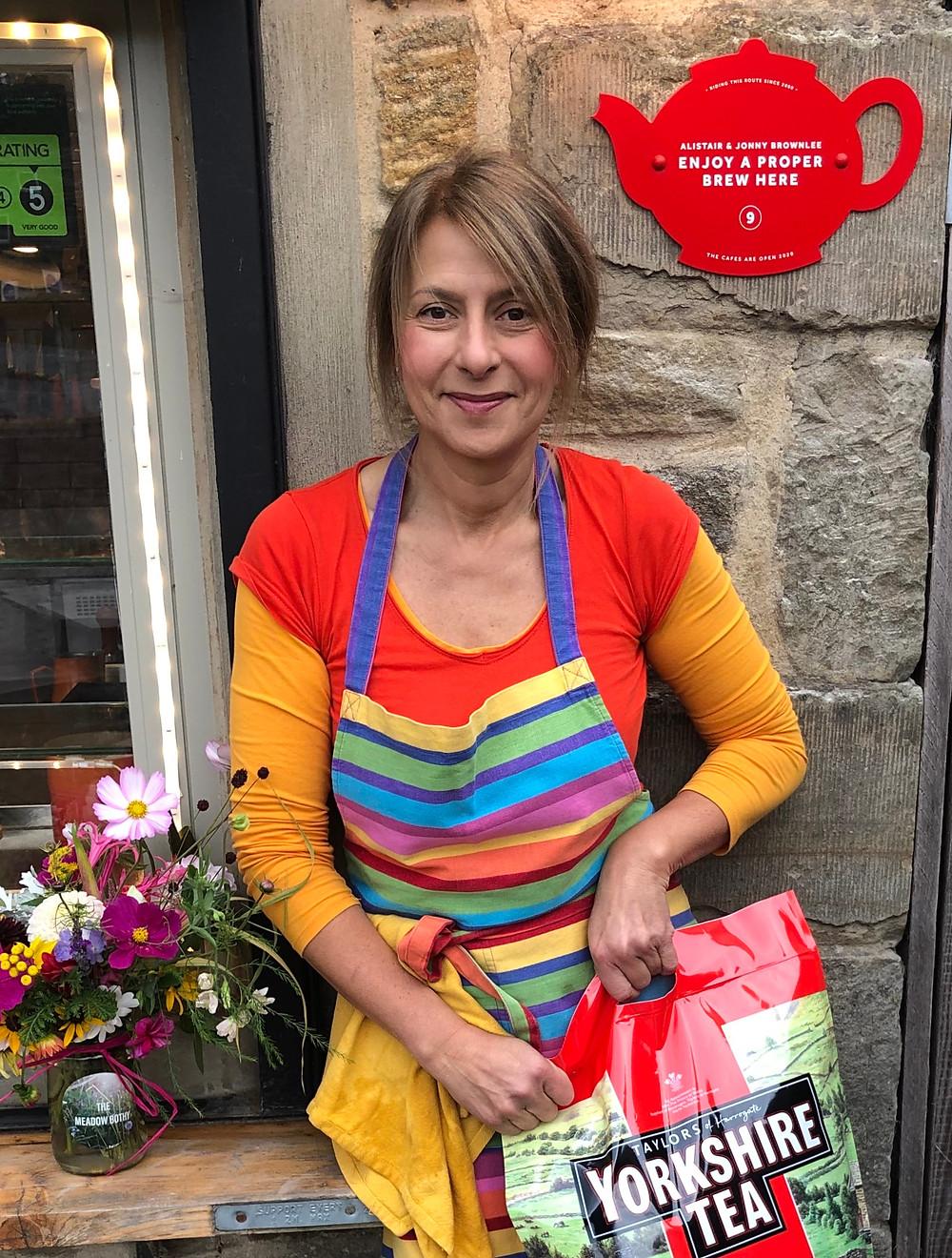Rachel in front of plaque with Yorkshire Tea