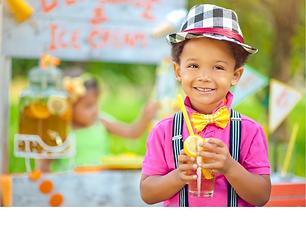 Host an event child smiling at a lemondade stand