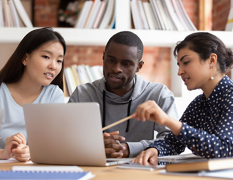 Multiethnic diverse students sit at desk
