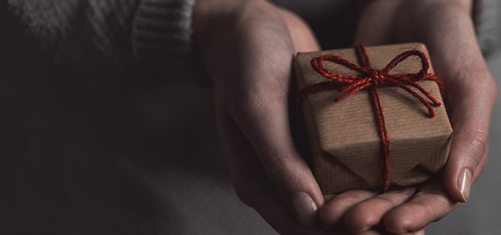 Hands carrying a personalised gift