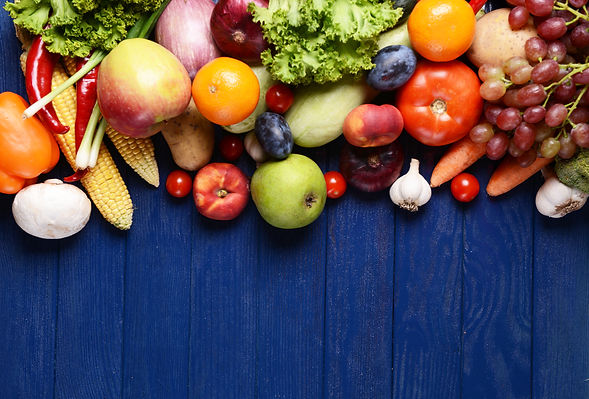 Fresh organic fruits and vegetables on w
