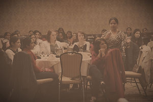 A woman asks a question of the CEO, Celebrating Women's Day, women who work in high tech, many from