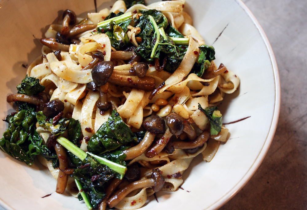 A bowl of Rallenti Gluten-Free Fettuccine Pasta Tossed in a Mushroom and Brown Butter Sauce.