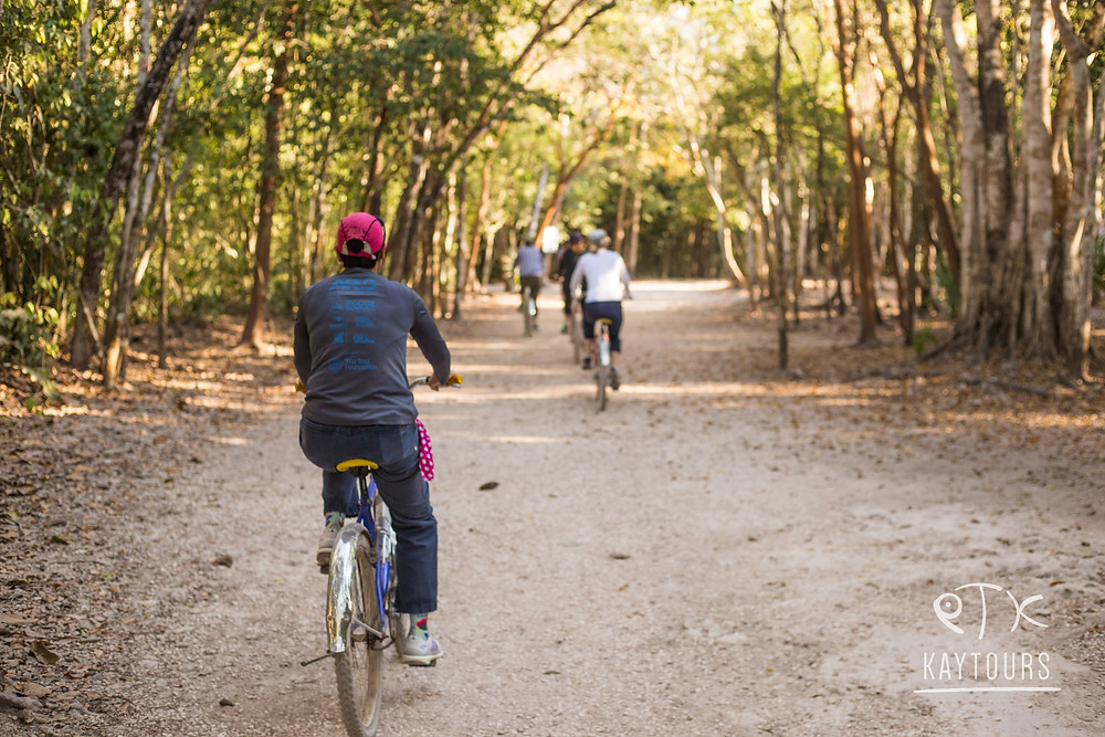 People riding bikes around the Coba archeological site in the Riviera Maya