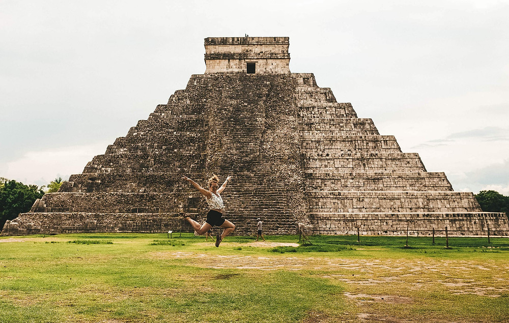 Claire from Claire's Itchy Feet jumping for joy at Chichen Itza