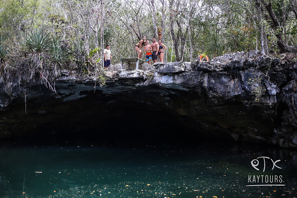 A family standing above a cenote in the Riviera Maya in Mexico