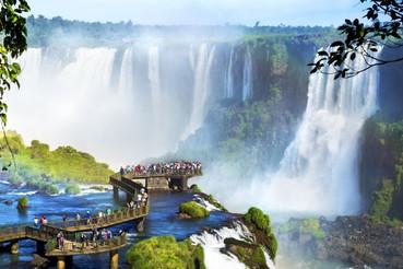 Tourists at Iguazu Falls, one of the wor