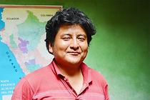 Peruvian man smiling. A map of Peru in t