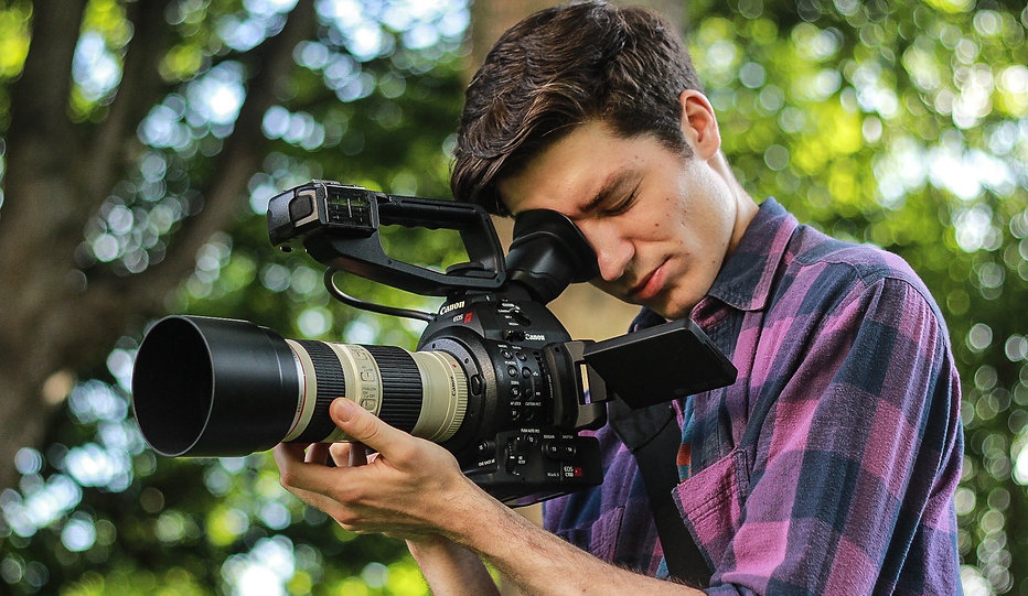 Dublin, Ireland freelance camera operator Daniel Harper with Canon C100 Mark2 for corporate and promotional online video content