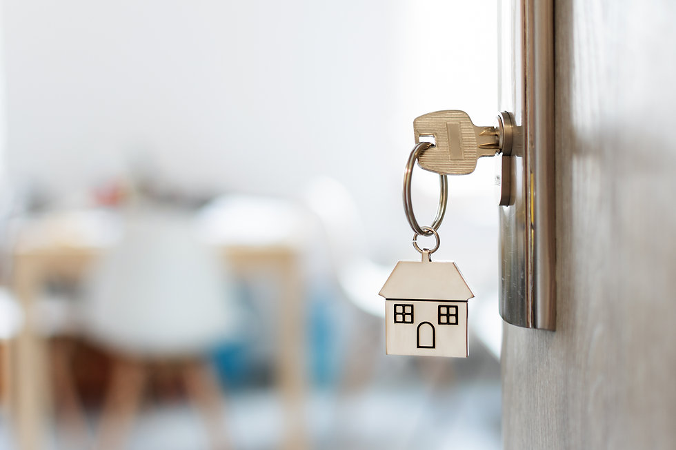 Key with keychain in a house shape in th