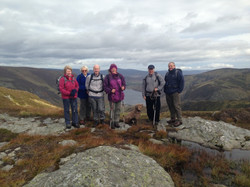 Hillwalking Group With Loch Lee In The Background