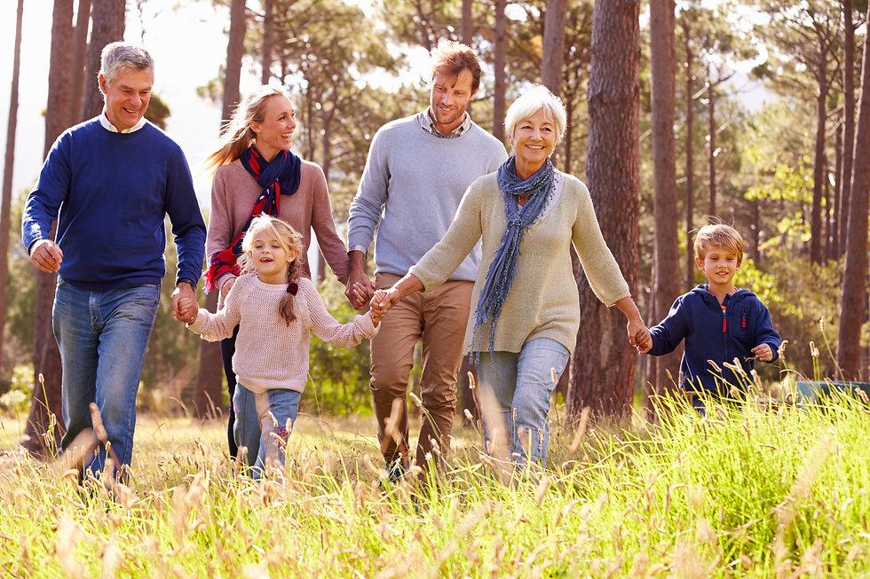 Happy multi-generation family walking in