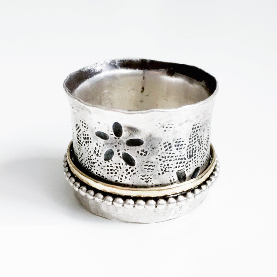 Floral silver spinner ring