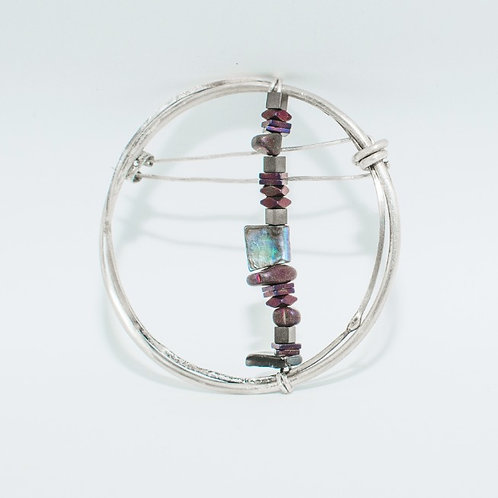 Brooch with beads.
