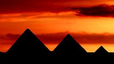 stock-footage-egyptian-pyramids-at-orange-dusk.jpg