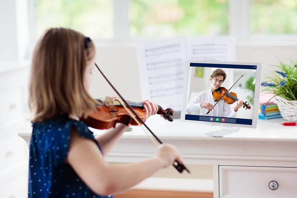 Child playing violin. Remote learning from home. Arts for kid. Little girl with musical in