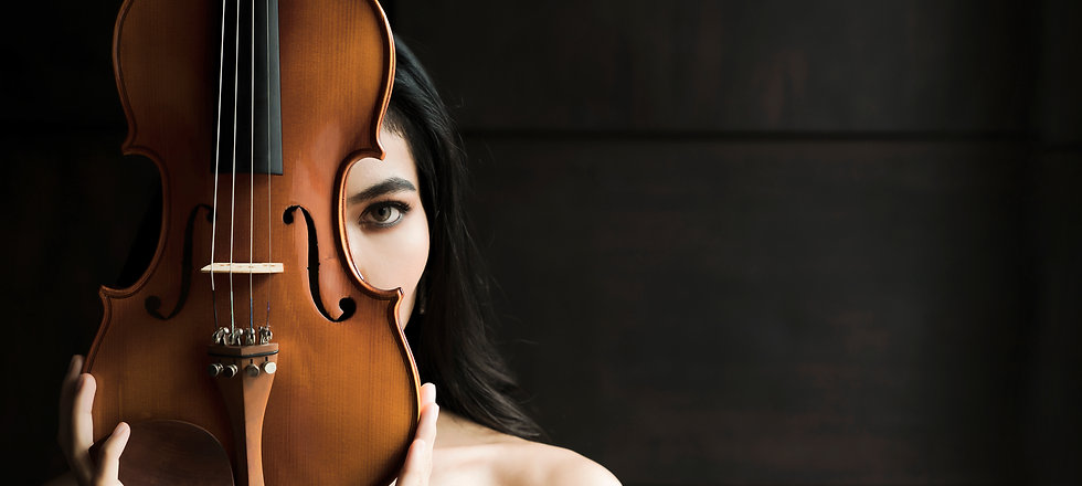 Close up portrait of young asian woman playing violin vintage style with copy space. Music