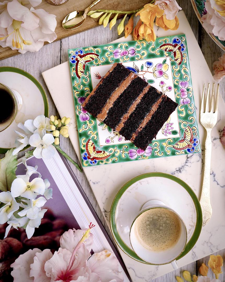 HAZELNUT CHOCOLATE SEA SALT CARAMEL ($) - Moist chocolate cake layers filled with hazelnut chocolate buttercream & salte caramel crisp pearls..