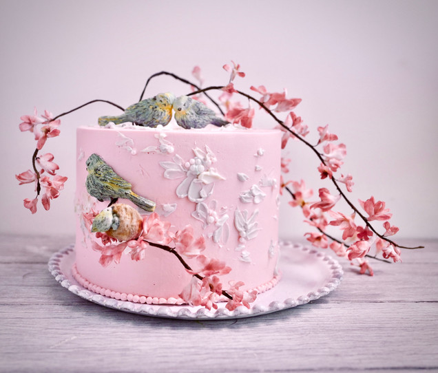 Reminiscent of traditional Chinese paintings, this delicate cake features pink blossom branches, sugar birds & free-flowing buttercream petals