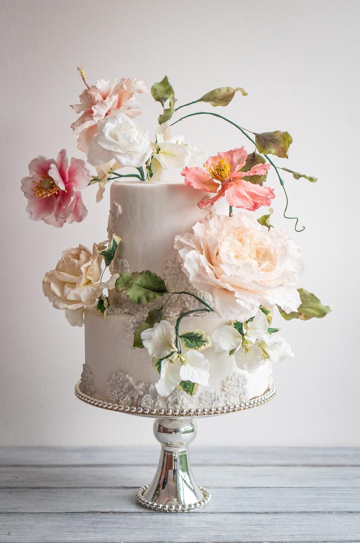 Bas relief wedding cake with sugar anemonies, hibiscus, peony, gardenia, wild rose, poppy & bougainvillea