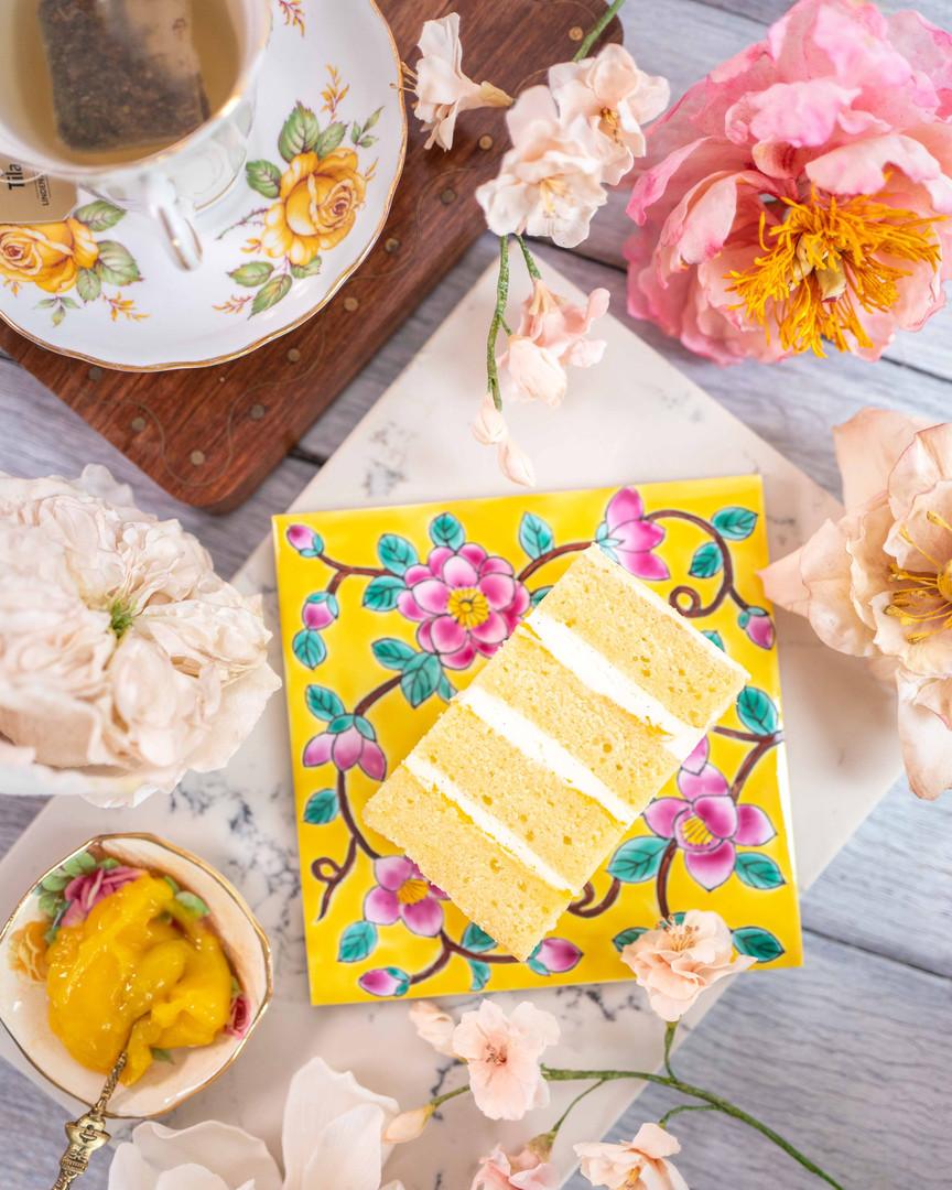 YUZU CHARMING ($) - Soft vanilla butter sponge cake filled with refreshing yuzu curd & smooth cream cheese buttercream.