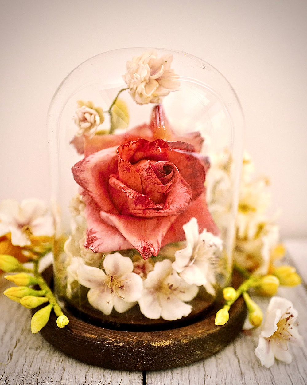 Sugar flowers in a glass cloche or bell jar