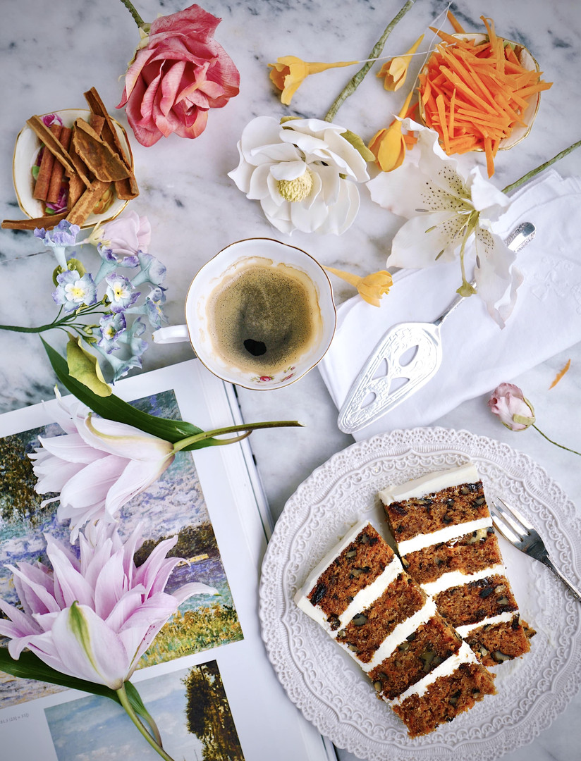 CARROT CONNOISSEUR (GF) ($) - Lightly spiced layers of moist carrot cake filled with classic cream cheese buttercream with fresh lemon zest. For a more decadent & boozy experience, choose to soak your cake layers with whiskey infused syrup (Premium flavour).