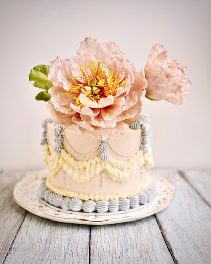 Delicate pale pink sugar peonies dress up vintage inspired buttercream piping even further