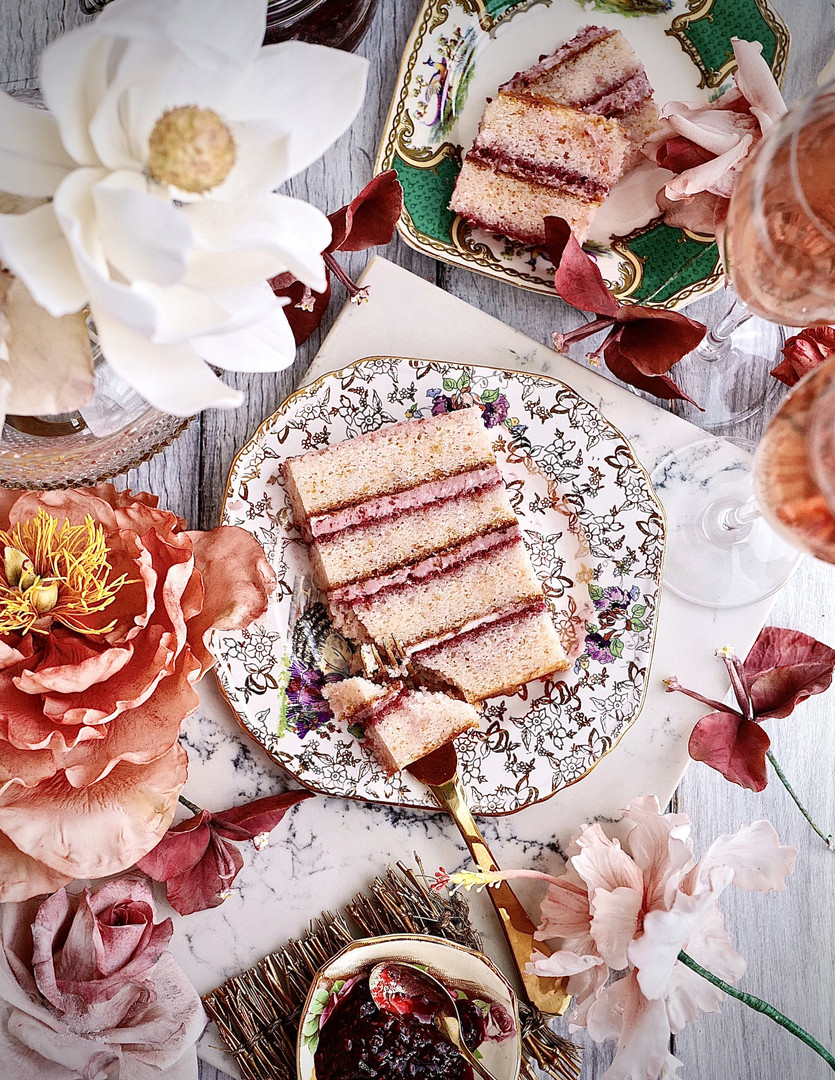 CHAMPAGNE CELEBRATION ($$) - Soft vanilla sponge cake infused with pink champagne, soaked with champagne syrup & filled with raspberry mascarpone buttercream.