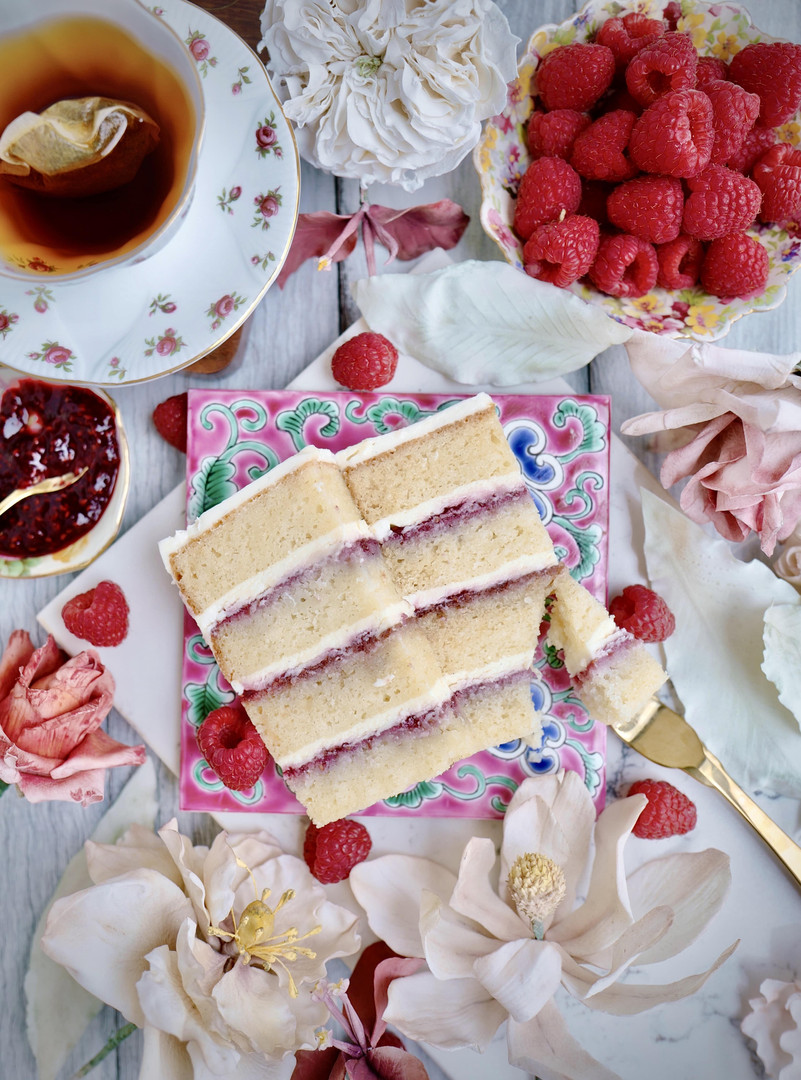 VANILLA ROSEBERRY ROMANCE ($) - Pillowy soft layers of vanilla white cake, filled with tart raspberry compote & rose scented buttercream.