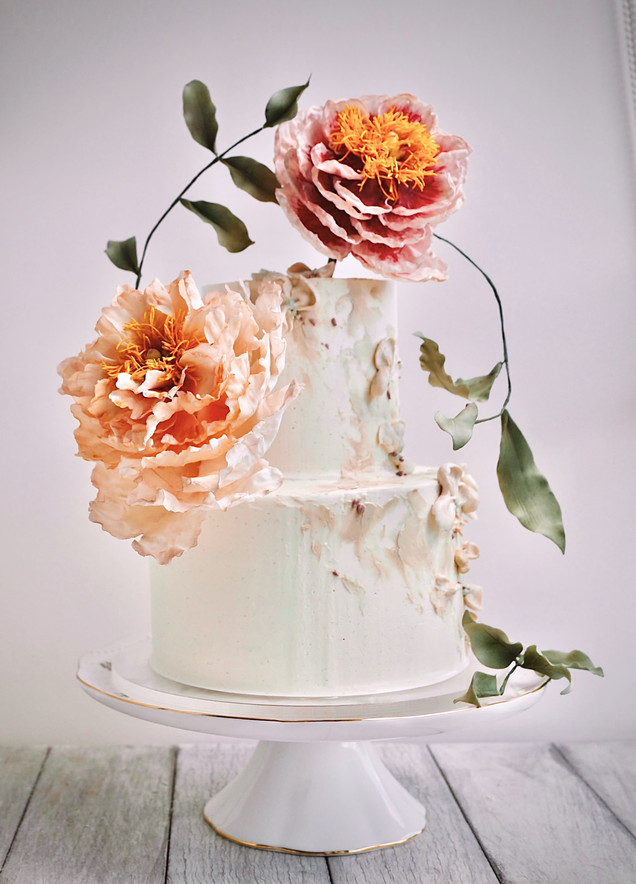 Romantic & whimsical wedding cake with showstopping handcrafted sugar peonies & abstract buttercream petals