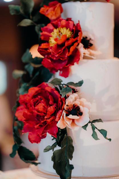Cascading & striking red peonies on wedding cake