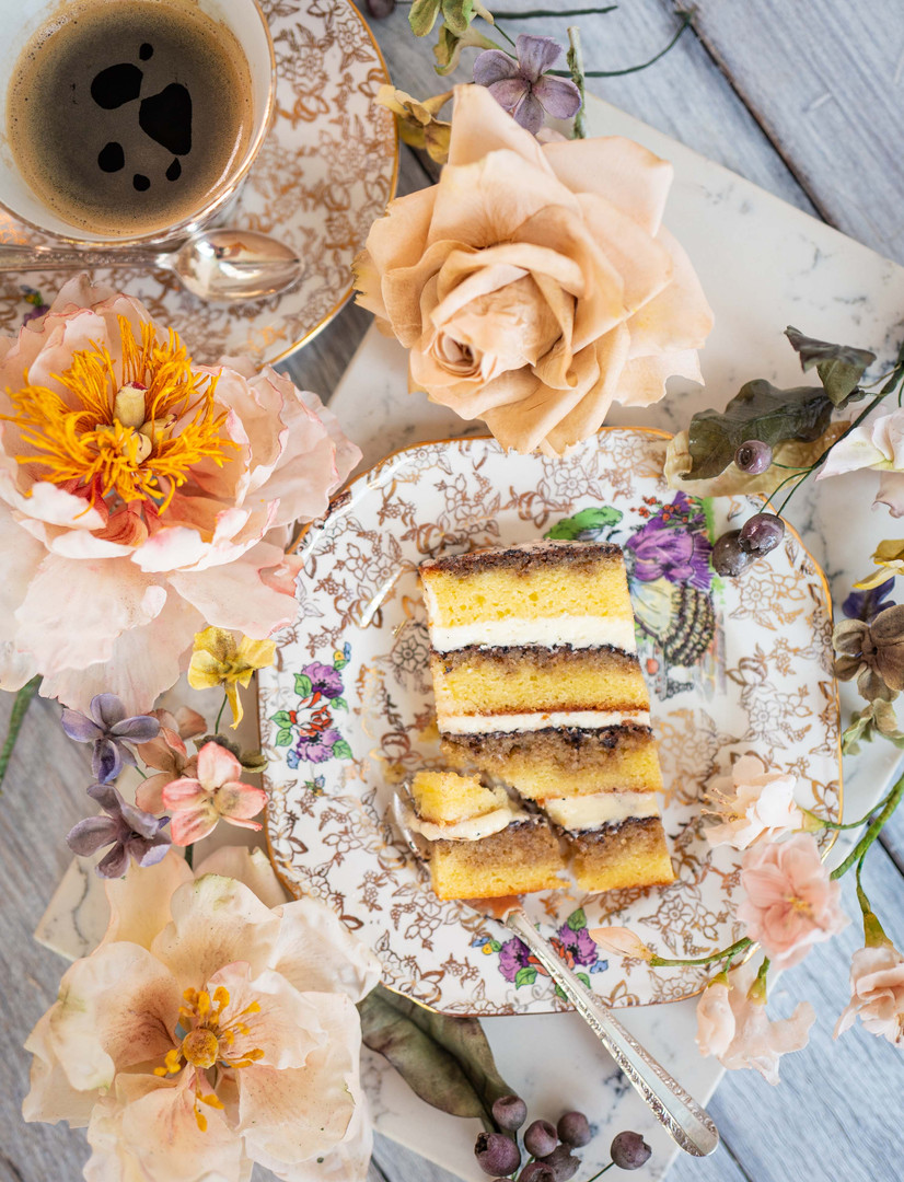 VINTAGE TIRAMISU ($$) - Layers of soft butter sponge cake soaked with Kahlua syrup and filled with fluffy mascarpone buttercream