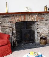 Lanthorn House, Porthcothan Bay, livingroom, log fire