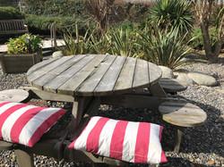 Bay garden seat with cushion