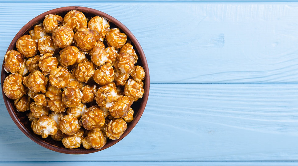 Sweet caramel popcorn . Food and snack b