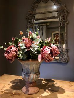 Dusky pink peonies in blue vase