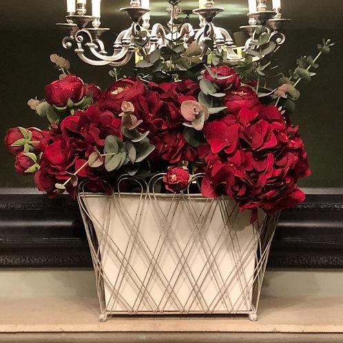 Velvet roses and hydrangeas in tin vase