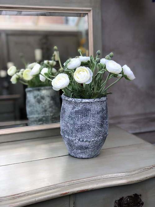 Creamy white ranunculus in grey pottery vase