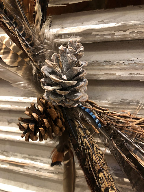 Pheasant feather wreath with cones
