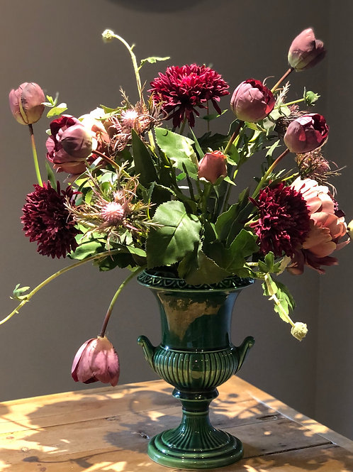 Deep reds and dark pinks in green urn