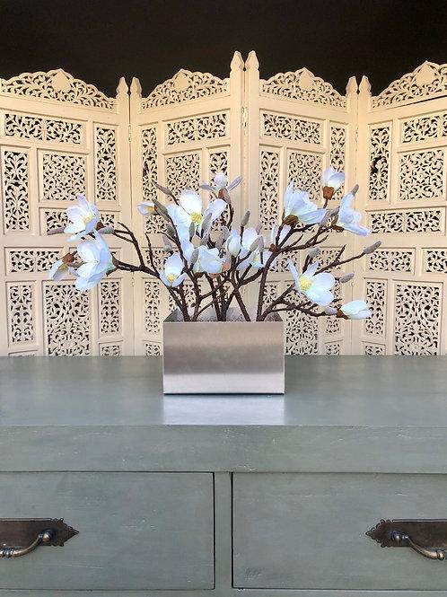 White magnolias in silver vase