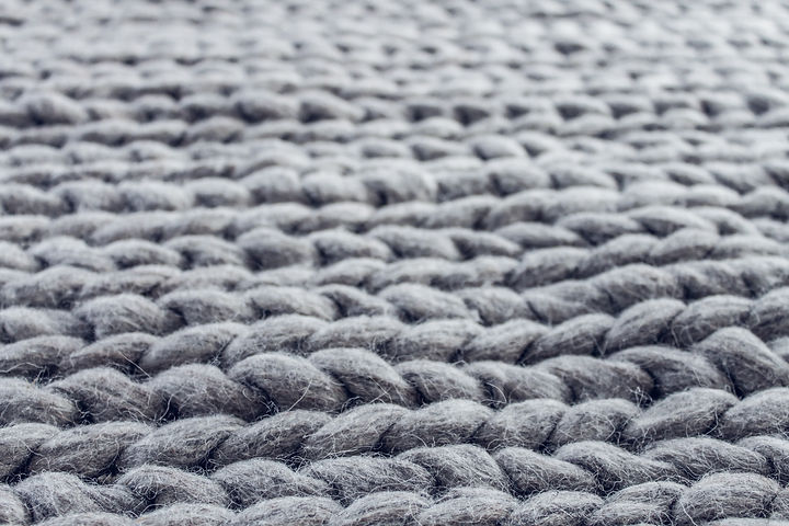 close-up-of-gray-cable-knit-cloth-142125