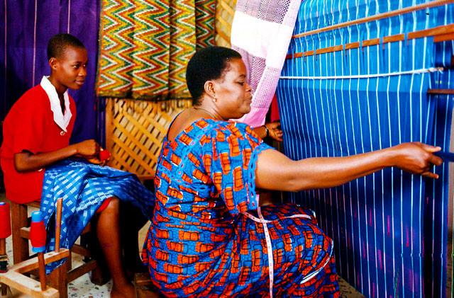 Aso-Oke Seller during the weaving process