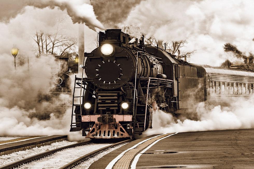 Retro steam train departs from the stati