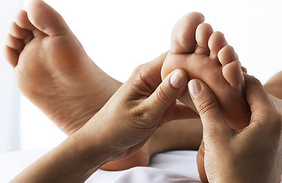 therapist_giving_a_reflexology_massage_o