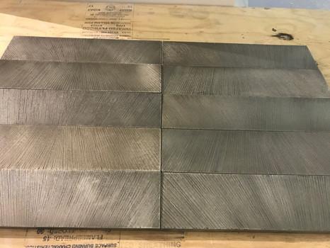 Wrapped metal tiles