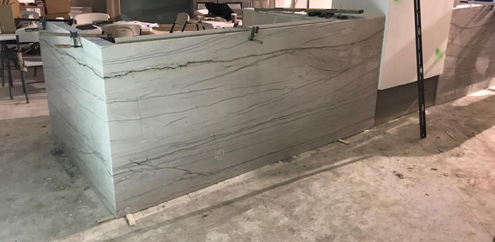 Bookmatch quartzite create a dramatic, intimate space for seating areas.