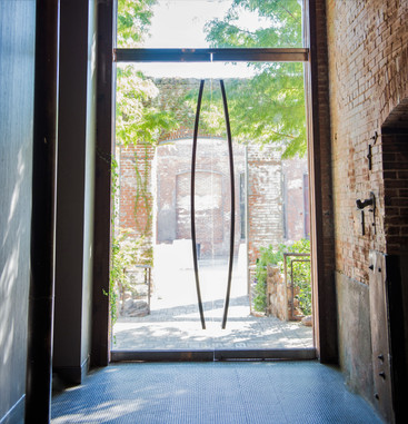 The glass doors were designed to appear transparent drawing one's view to the garden beyond.