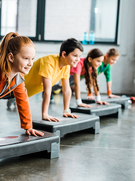 Children doing plank exercise with step